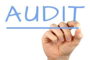Man writing audit