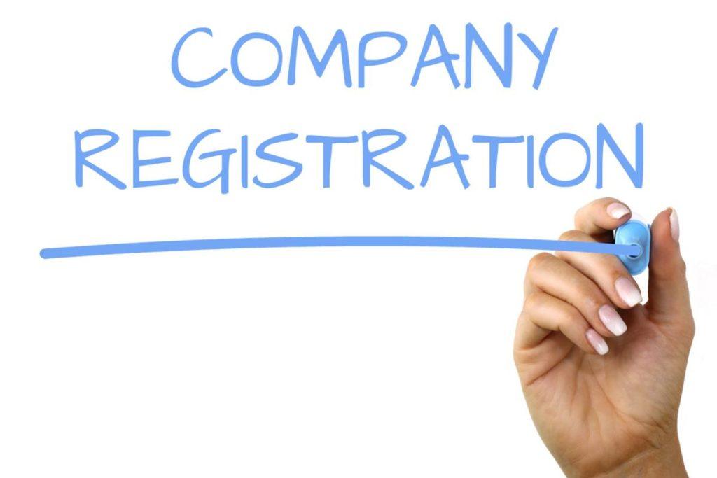 man writing company registration